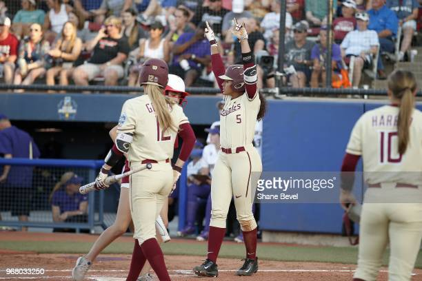 Elizabeth Mason of the Florida State Seminoles celebrates after scoring against the Washington Huskies during the Division I Women's Softball...