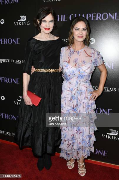 "Elizabeth McGovern and Victoria Hill attend the premiere of PBS' ""The Chaperone"" at Linwood Dunn Theater on April 03, 2019 in Los Angeles, California."