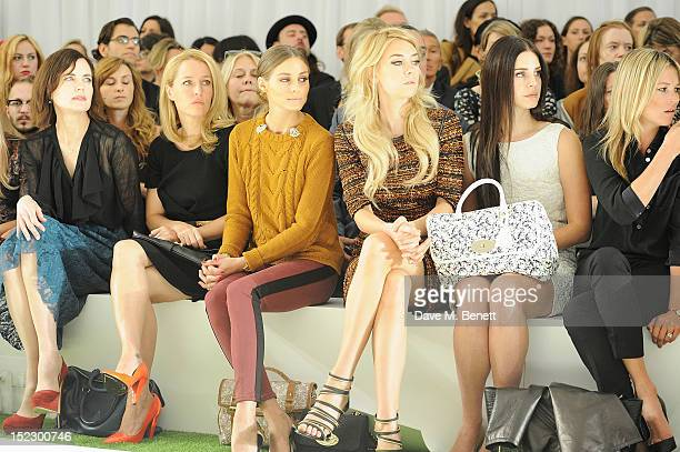 Elizabeth McGovern Gillian Anderson Olivia Palermo Vanessa Kirby Lana Del Rey and Kate Moss sit in the front row during the Mulberry Spring/Summer...