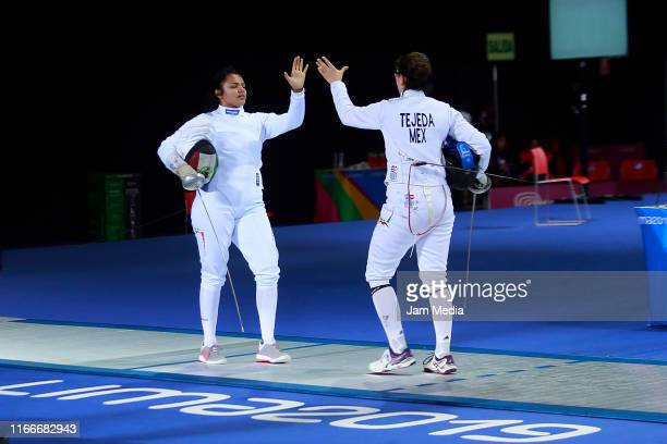 Elizabeth Medina and Liliana Tejeda of Mexico shake hands in Fencing Women's Épée Individual Table of 16 on Day 12 of Lima 2019 Pan American Games at...