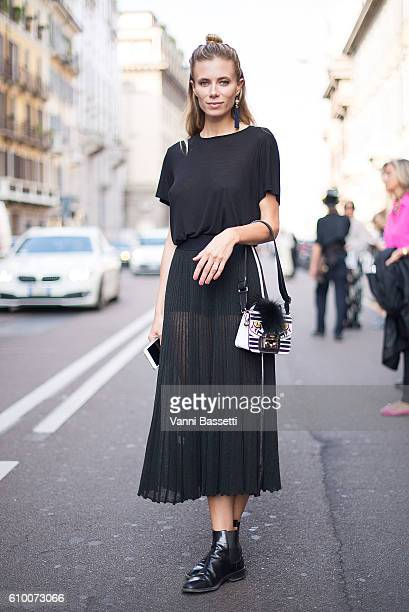 Elizabeth Minett poses after the Les Copains show during Milan Fashion Week Spring/Summer 2017 on September 22 2016 in Milan Italy