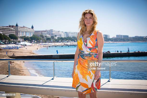 Elizabeth Mitchell poses during the 'Crossing Lines The Time Is Now' photocall at MIPTV on April 13 2015 in Cannes France