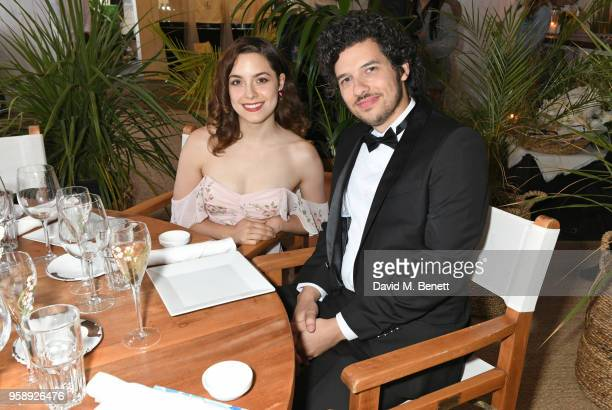 Elizabeth Moroni and Rich Vreeland aka Disasterpeace pose at Nikki Beach for the Under The Silver Lake dinner presented by PerrierJouet at Nikki...