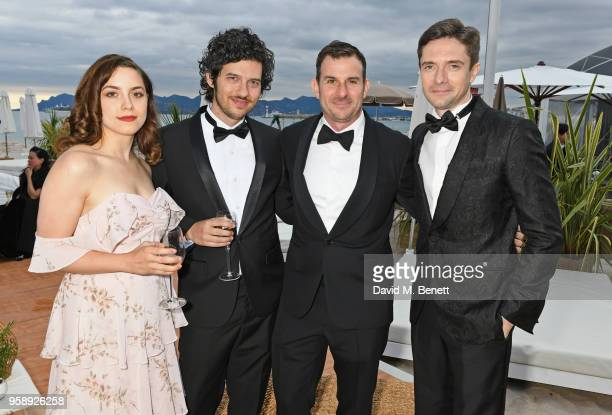 Elizabeth Moroni Rich Vreeland Chris Bender and Topher Grace pose at Nikki Beach for the Under The Silver Lake dinner presented by PerrierJouet at...