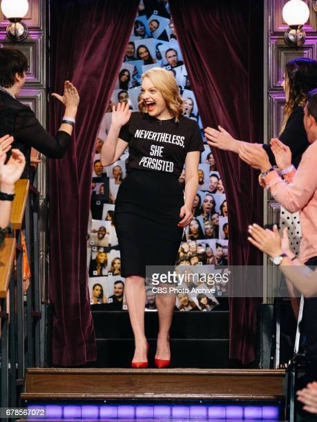 Elizabeth Moss greets the crowd during The Late Late Show with James Corden Wednesday April 26 2017 On The CBS Television Network