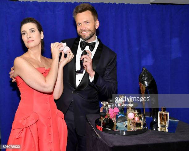 Elizabeth Mumsmanno and Joel McHale pose backstage at the 2017 Fragrance Foundation Awards Presented By Hearst Magazines at Alice Tully Hall on June...