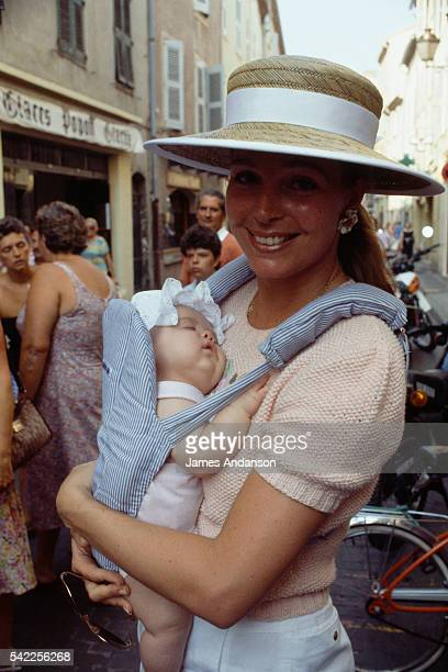 Elizabeth Najeeb Halaby who became Queen Noor al Hussein of Jordan upon her marriage to King Hussein of Jordan holding her new born daughter the...