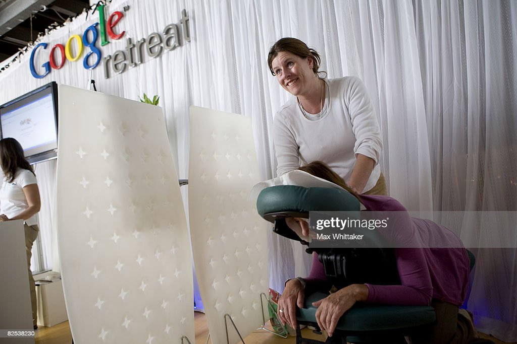 Elizabeth Nietch gives a free massage to Alice Kelly of ZDF, a German television network, at the Google Retreat on the eve of the Democratic National Convention (DNC) August 24, 2008 in Denver, Colorado. The city is preparing to host the 2008 DNC at the Pepsi Center from August 25th through the 28th.