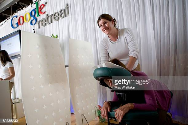 Elizabeth Nietch gives a free massage to Alice Kelly of ZDF a German television network at the Google Retreat on the eve of the Democratic National...