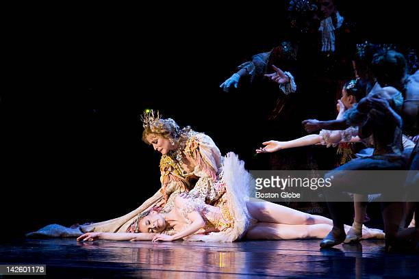 Elizabeth Olds as the Queen and Larissa Ponomarenko as Princess Aurora laying down during the Boston Ballet's dress rehearsal for The Sleeping Beauty...