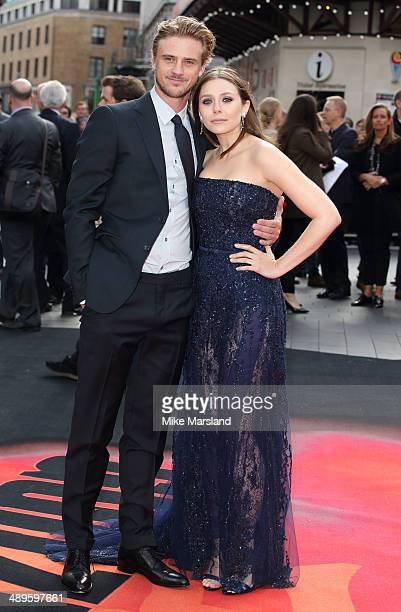 Elizabeth Olsen and Boyd Holbrook attend the European premiere of Godzilla at Odeon Leicester Square on May 11 2014 in London England