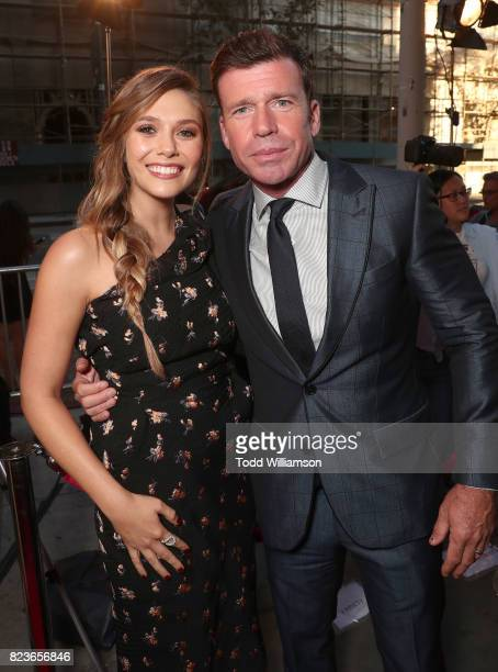 Elizabeth Olsen and Director Taylor Sheridan attend the premiere Of The Weinstein Company's 'Wind River' at The Theatre at Ace Hotel on July 26 2017...