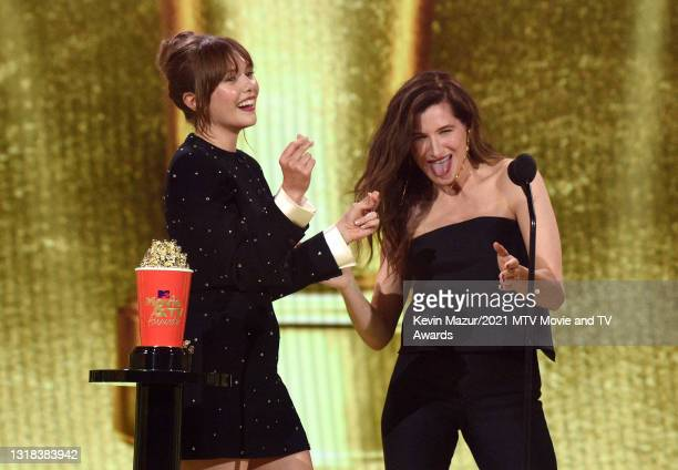 Elizabeth Olsen and Kathryn Hahn accept the Best Show award for 'WandaVision' onstage during the 2021 MTV Movie & TV Awards at the Hollywood...