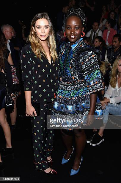 Elizabeth Olsen and Lupita Nyong'o attend KENZO x HM Launch Event Directed By JeanPaul Goude' at Pier 36 on October 19 2016 in New York City