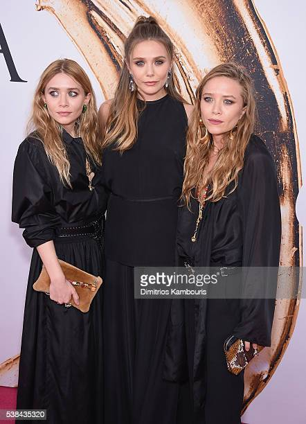 Elizabeth Olsen and MaryKate and Ashley Olsen attend the 2016 CFDA Fashion Awards at the Hammerstein Ballroom on June 6 2016 in New York City