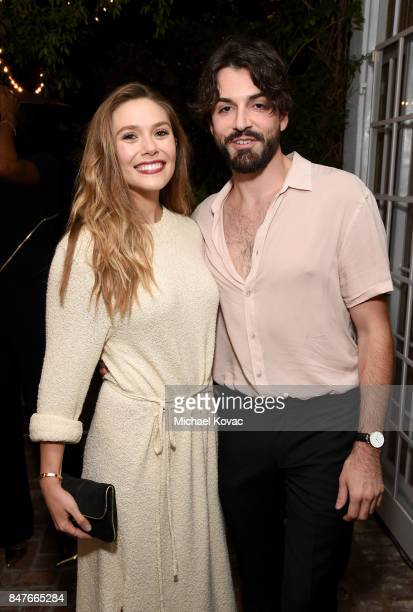 Elizabeth Olsen and Robbie Arnett attend the 2017 Gersh Emmy Party presented by Tequila Don Julio 1942 on September 15 2017 in Los Angeles California