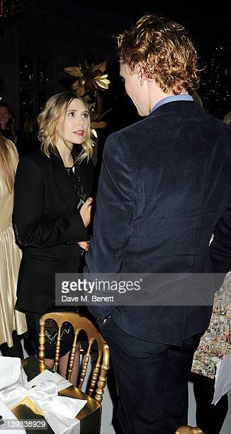 Elizabeth Olsen and Tom Hiddleston attend a dinner following the Mulberry Autumn/Winter 2012 show during London Fashion Week at The Savile Club on...