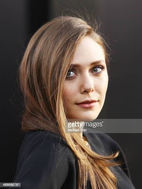 """Elizabeth Olsen arrives at the Los Angeles premiere of """"Godzilla"""" held at Dolby Theatre on May 8, 2014 in Hollywood, California."""