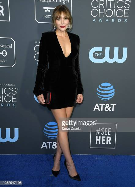 Elizabeth Olsen arrives at the The 24th Annual Critics' Choice Awards attends The 24th Annual Critics' Choice Awards at Barker Hangar on January 13...