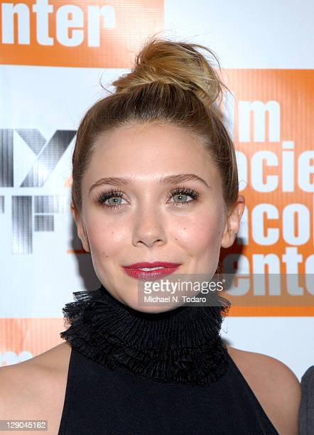 Elizabeth Olsen attends the 49th annual New York Film Festival presentation of 'Martha Marcy May Marlene' at Alice Tully Hall Lincoln Center on...
