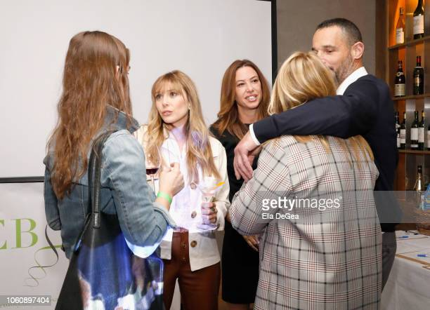 Elizabeth Olsen Cynthia Pett Dante and guests attend the EBMRF hosts Sip Savor Support at Wally's Beverly Hills on November 12 2018 in Beverly Hills...