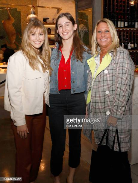 Elizabeth Olsen guest and Cynthia Pett Dante attend the EBMRF hosts Sip Savor Support at Wally's Beverly Hills on November 12 2018 in Beverly Hills...