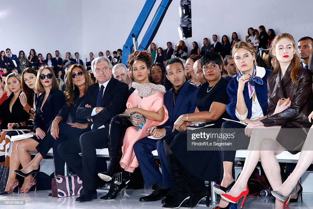 Elizabeth Olsen, Guest, Emilia Clarke, CEO Dior Sidney Toledano with his wife Katia Toledano, Rihanna, her Brother, her Mother Monica Braithwaite, Guest and Agathe Bonitzer attend the Christian Dior show as part of the Paris Fashion Week Womenswear Spring/Summer 2016. Held at Cour Carre du Louvre on October 2, 2015 in Paris, France.
