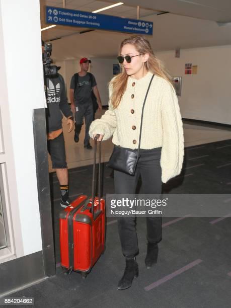 Elizabeth Olsen is seen at Los Angeles International Airport on December 01 2017 in Los Angeles California