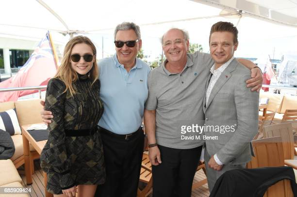 Elizabeth Olsen Victor Hadida Samuel Hadida and Jeremy Renner attend a lunch hosted by Lexus for The Weinstein Company's 'Wind River' stars and...