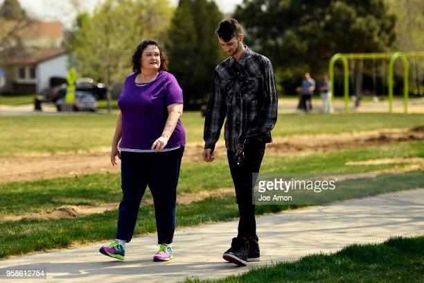 Elizabeth Pate 58 and her adopted son Stephen Morgan 22 walk in a park near their home in Broomfield Stephen came to live with Elizabeth in December...