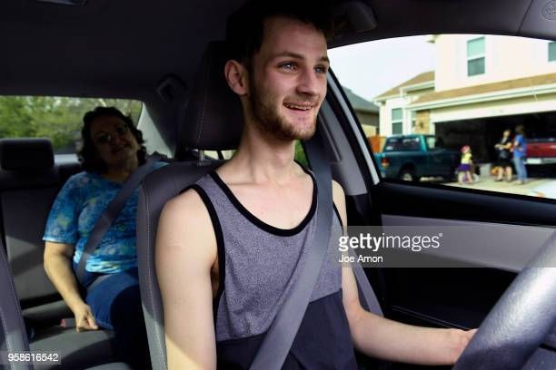 Elizabeth Pate 58 in the backseat as her adopted son Stephen Morgan 22 takes his 3rd driving lesson near their home in Broomfield Stephen has had his...