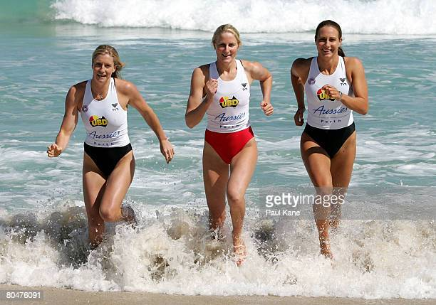 Elizabeth Pluimers of QLD Alicia Marriot of WA and Kristy Munroe of QLD race up the beach during the 2008 Australian Surf Lifesaving Championships...