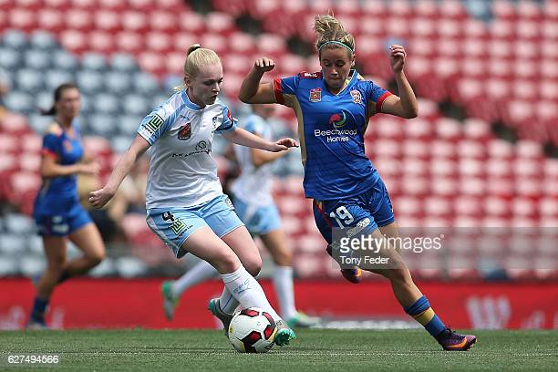 Elizabeth Ralston of Sydney contests the ball with Ashlee Brodigan of the Jets during the round five WLeague match between the Newcastle Jets and...