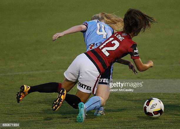 Elizabeth Ralston of Sydney is challenged by Rachel Lowe of the Wanderers during the round nine WLeague match between Western Sydney and Sydney at...
