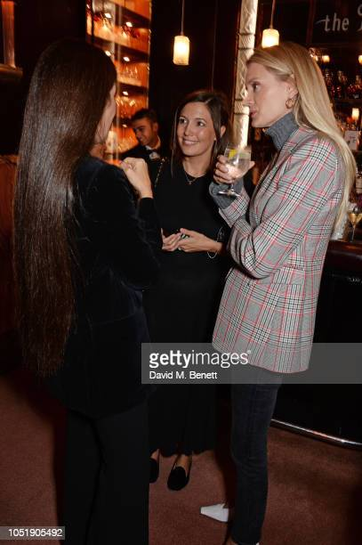 Elizabeth Saltzman Amanda Sheppard and Rebecca Corbin Murray attend the Michael Kors cocktail party to celebrate the collaboration with David Downton...
