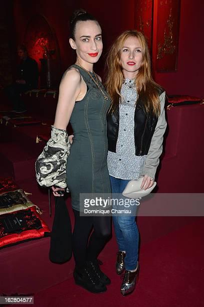 Elizabeth Scarlett Jagger and Josephine de La Baume attend the HM Fashion Show Fall/Winter 2013 ReadytoWear show as part of Paris Fashion Week on...