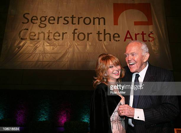 Elizabeth Segerstrom and Founding Chairman Henry Segerstrom celebrate on stage at the Orange County Perfroming Arts Center's renaming ceremony to...