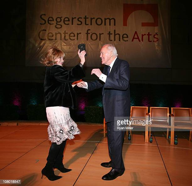 Elizabeth Segerstrom and Founding Chairman Henry Segerstrom dance on stage at the Orange County Perfroming Arts Center's renaming ceremony to...