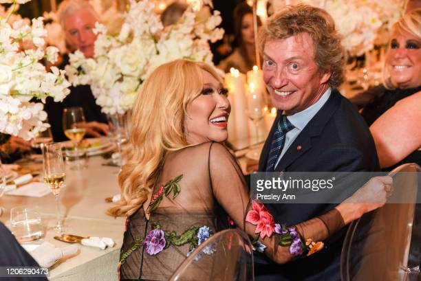 Elizabeth Segerstrom and Nigel Lythgoe attend Of Love And Rage Premiere Dinner Hosted By Elizabeth Segerstrom at Leatherby's Cafe Rouge on March 7...