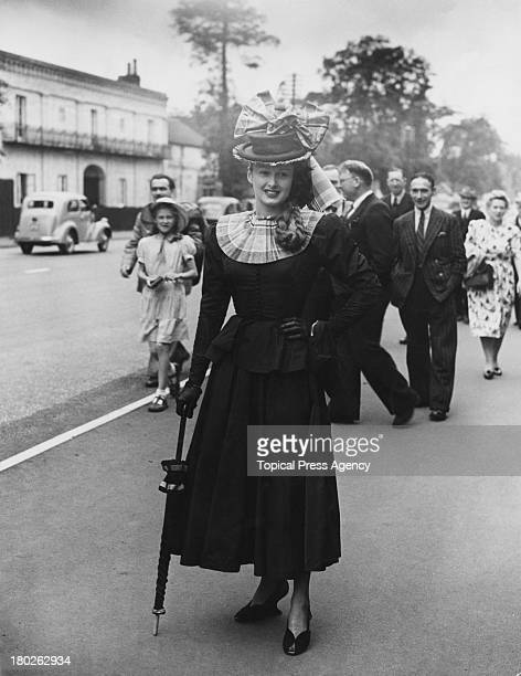 Elizabeth Shelley wearing a peplum jacket and threequarterlength skirt on the first day of the Royal Ascot racemeeting Ascot Berkshire 15th June 1948