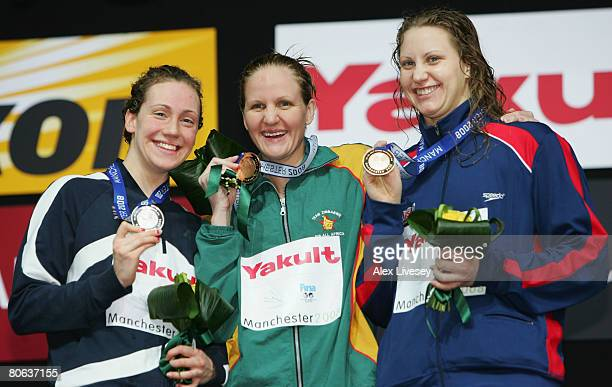 Elizabeth Simmonds of United Kingdom celebrates the silver medal Kirsty Coventry of Zimbabwe the gold medal and Margaret Hoelzer of United States the...