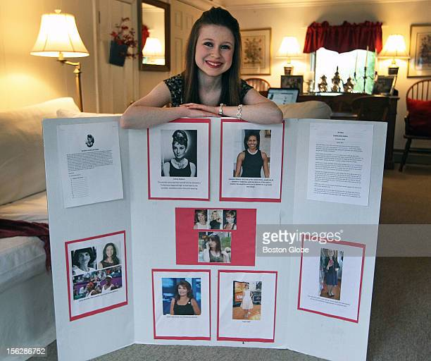 Elizabeth Skerry a junior at Timberlane Regional High School is pictured at her home posing with the tri fold board she created and presented to the...