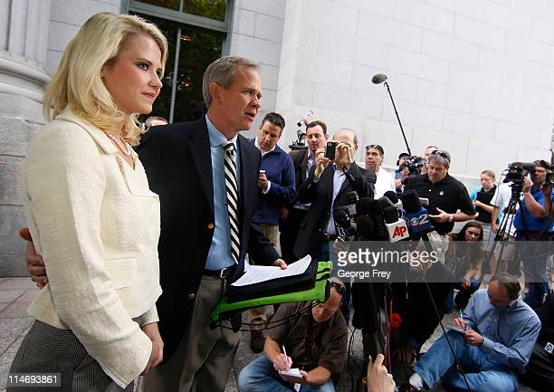 Elizabeth Smart listens to her father Ed Smart talk to the press outside of federal court after the sentencing of Elizabeths kidnapper Brian David...