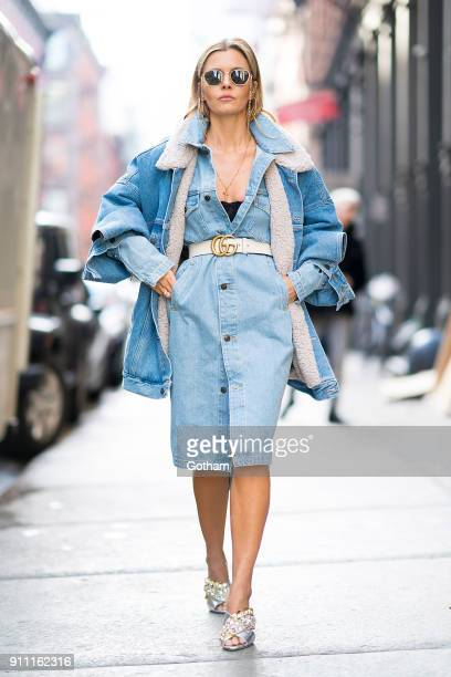 Elizabeth Sulcer is seen wearing a TNA dress Marcelo Burlon jacket Gedebe shoes with Alessandra Rich glasses Gucci belt and Jennifer Fisher earrings...
