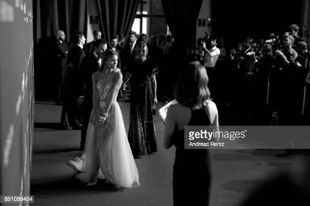 Elizabeth Sulcer walks the red carpet of amfAR Gala Milano on September 21 2017 in Milan Italy