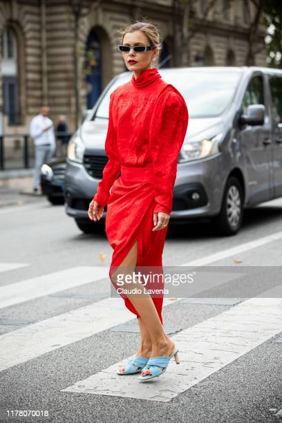 Elizabeth Sulcer wearing a red midi dress and light blue sandals is seen outside the Redemption show during Paris Fashion Week Womenswear Spring...