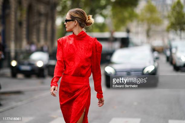 Elizabeth Sulcer wears a red damask dress sunglasses outside Redemption during Paris Fashion Week Womenswear Spring Summer 2020 on September 26 2019...