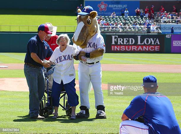 Elizabeth Sullivan a 105 year old Texas Rangers fan throws the first pitch before the game against the Seattle Mariners at Rangers Global Life Park...