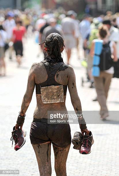 PM Elizabeth Tapper of Denver Co walks the streets of Vail Co covered in mud after the Mud Run at the 10th Annual Teva Mountain Games in Vail Co...