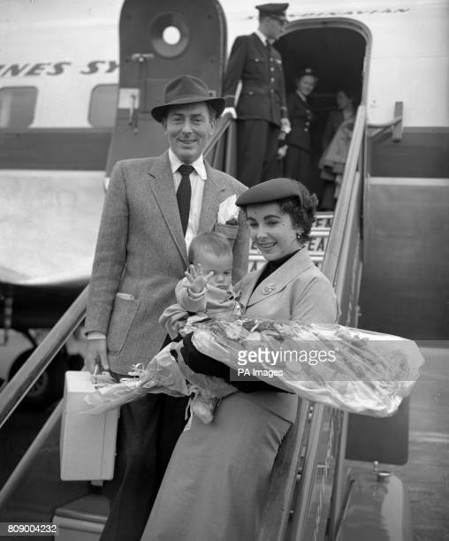Elizabeth Taylor accompanied by her film star husband Michael Wilding and their infant son Michael Wilding Jr at Heathrow Airport